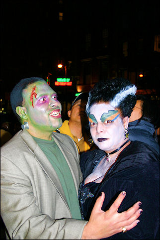 USA, New York - Frankenstein and his bride watch the Halloween Parade in The Village
